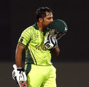 Pakistan's Sarfraz Ahmed kisses his helmet as he celebrates reaching his century during the Cricket World Cup match against Ireland at the Adelaide Oval